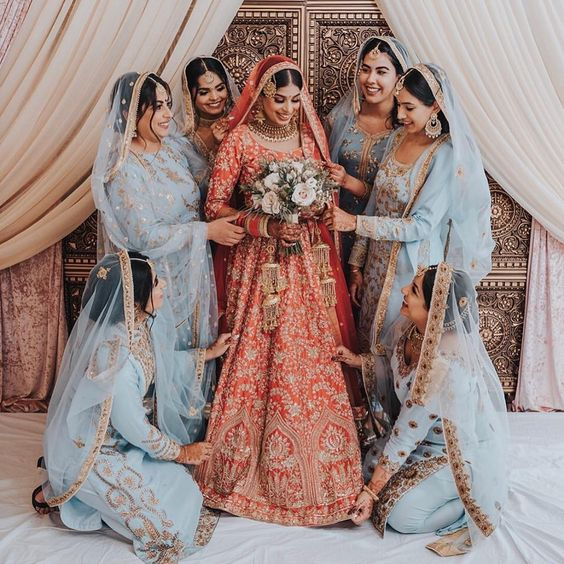 Indian bride and bridesmaids in Wellgroomed red bridal lehenga and blue bridesmaid lehengas. #Frugal2Fab